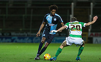 Sido Jombati of Wycombe Wanderers takes on Wes Fogden of Yeovil Town during the Sky Bet League 2 match between Yeovil Town and Wycombe Wanderers at Huish Park, Yeovil, England on 24 November 2015. Photo by Andy Rowland.
