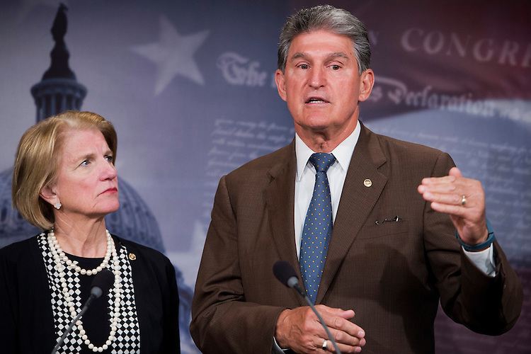 "UNITED STATES - MAY 13: Sens. Shelley Moore Capito, R-W.Va., and Joe Manchin, D-W.Va., conduct a news conference in the Capitol's Senate studio to introduce greenhouse gas legislation that aims to ""rollback President Obama's Clean Power Plan,"" May 13, 2015. (Photo By Tom Williams/CQ Roll Call)"