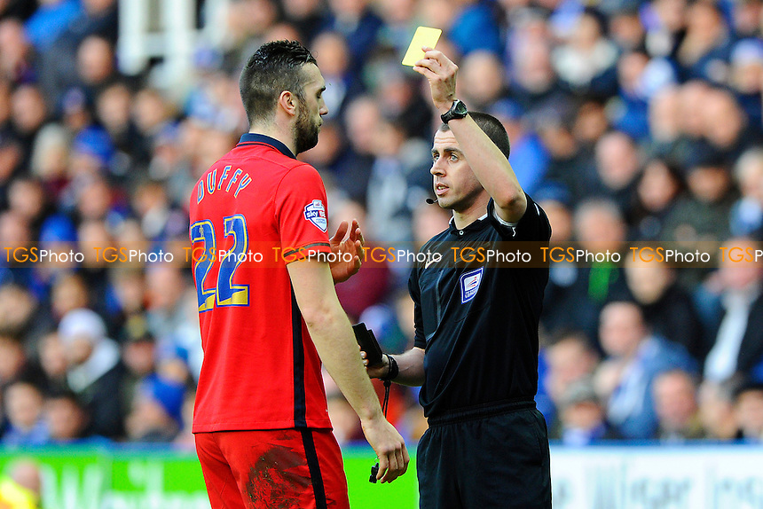 Referee Peter Bankes gives a yellow card to Shane Duffy of Blackburn Rovers during Reading vs Blackburn Rovers at the Madejski Stadium
