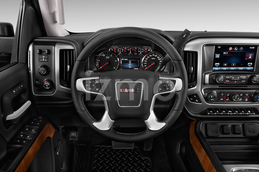 Car pictures of steering wheel view of a 2018 GMC Sierra 2500HD 2WD Crew Cab Standard Box SLT 4 Door Pick Up