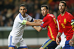 Spain's Sergio Busquets (c) and Sergio Ramos (r) and Israel's Eran Zahavi during FIFA World Cup 2018 Qualifying Round match. March 24,2017.(ALTERPHOTOS/Acero)