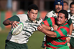 Michael Lea tries to fend off the tackle of Ra Garmonsway. Counties Manukau Premier Club Rugby game between Wauku & Manurewa played at Waiuku on Saturday June 6th. Manurewa won 36 - 31 after leading 14 - 12 at halftime.