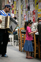 Roma gypsy street musician playing the accordion for the restaurants in Beyoglu, Istanbul, Turkey
