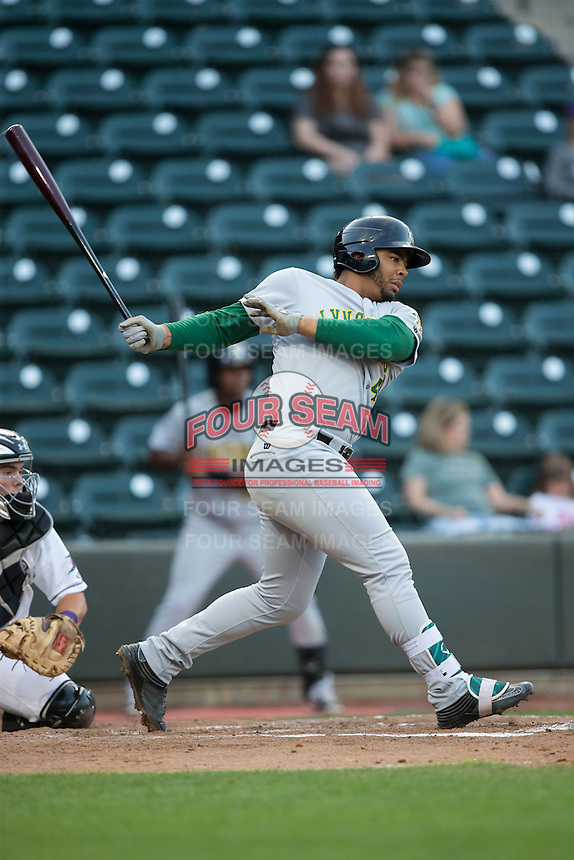 Bobby Bradley (44) of the Lynchburg Hillcats follows through on his swing against the Winston-Salem Dash at BB&T Ballpark on April 28, 2016 in Winston-Salem, North Carolina.  The Dash defeated the Hillcats 4-1.  (Brian Westerholt/Four Seam Images)