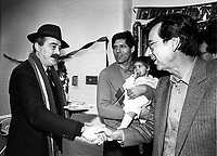 Montreal (QC) CANADA file photo - Dec 19 1987 - Jacques Chagnon, (M) hold a baby while Nick Auf Der Maur (L) shake hand with Robert Bourassa (R)  at Sun Youth