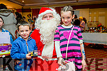Sam and Hannah Sheehan from Castleisland with Santa  at the Castleisland Christmas Craft Fair in the River Island Hotel on Saturday.
