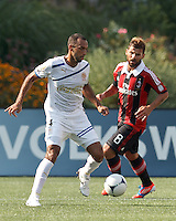 C.D. Olimpia defender Fabio de Souza (4) controls the ball. In an international friendly, AC Milan defeated C.D. Olimpia, 3-1, at Gillette Stadium on August 4, 2012.