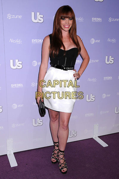 JESSICA SUTTA.US Weekly's Hot Hollywood 2008 Party at Beso Restaurant, Hollywood, California, USA, 17 April 2008..full length white skirt black top hand on hip clutch bag strappy shoes straps sandals fringe .CAP/ADM/BP.©Byron Purvis/Admedia/Capital PIctures