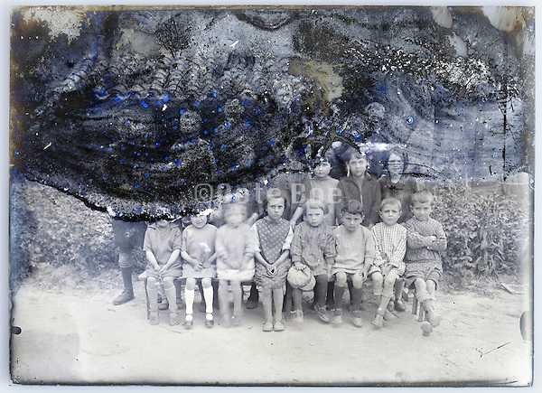 eroding glass plate photo of formal class group photo with little school children