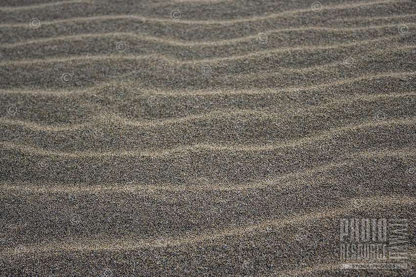 A wave pattern in the sand, Kalalau Beach, Na Pali Coast, Kaua'i.