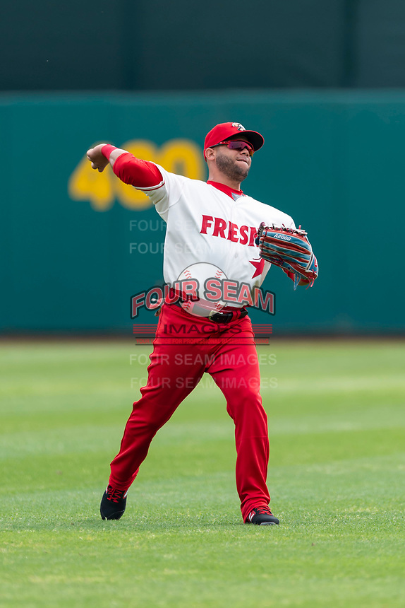Fresno Grizzlies outfielder Yadiel Hernandez (13) warms up before a game against the Reno Aces at Chukchansi Park on April 8, 2019 in Fresno, California. Fresno defeated Reno 7-6. (Zachary Lucy/Four Seam Images)