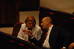 Israeli Foreign Affairs Minister Tzipi Livni (L) and Israeli Prime Minister Ehud Olmert (R) at a voting session in the Knesset May 7th, 2007.<br /> Several Israeli parties, from left to right, have put a voting proposals against Olmert's government on the parliament agenda, following the Winograd Report.<br /> (Photo by Ahikam Seri).