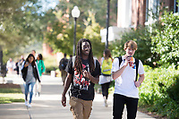 Students walking in between classes - sidewalk next to Colvard Student Union.<br />  (photo by Megan Bean / &copy; Mississippi State University)
