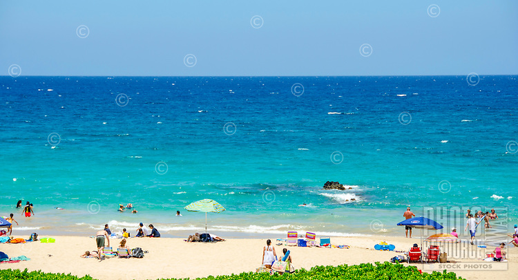 People enjoying a sunny day at Hapuna Beach, along the Big Island's Kohala Coast. This white sand beach has been rated one of the best beaches in the world time and time again.