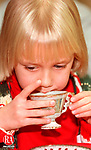 SOUTHBURY, CT 12/13/98 --1213JH10.tif--Chelsea Marcik, 6, of Southbury sips on some hot apple juice during the Teddy Bear Tea at the Old Town Hall Museum in South Britain Sunday. The event was sponsored by the Southbury Historical Society. JOHN HARVEY staff photo for Motz story.