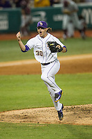 LSU Tigers pitcher Collin Strall (30) leaps off the mound celebrating the end of the eighth inning of the Southeastern Conference baseball game against the Texas A&M Aggies on April 23, 2015 at Alex Box Stadium in Baton Rouge, Louisiana. LSU defeated Texas A&M 4-3. (Andrew Woolley/Four Seam Images)