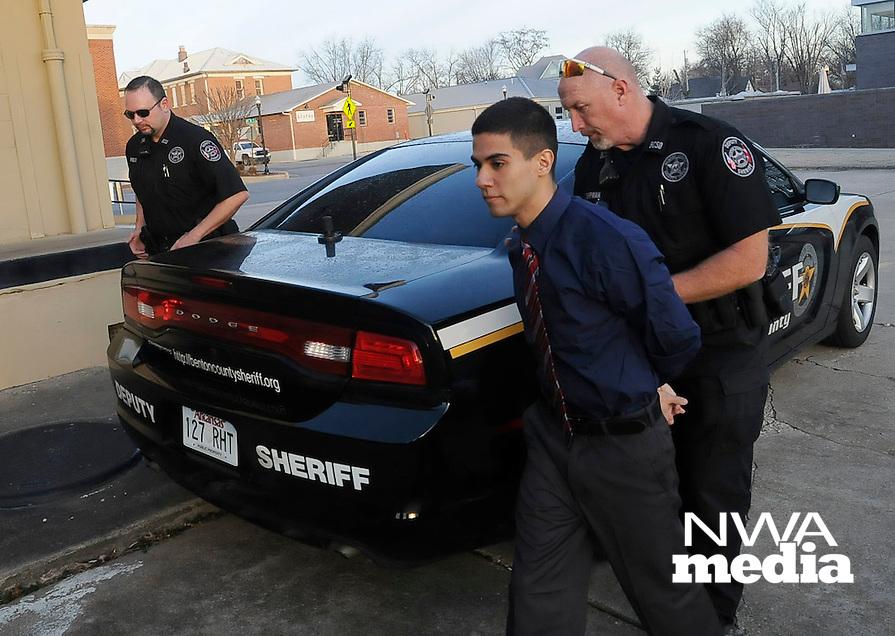 NWA Democrat-Gazette/FLIP PUTTHOFF <br /> Deputies bring Ali Matar to court in Bentonville on Friday Jan. 30 2015.