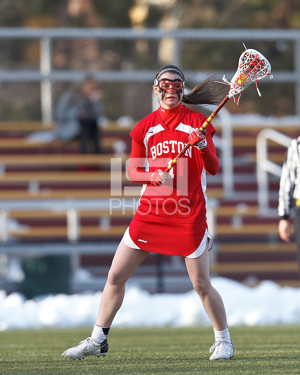 Boston University midfielder Jill Horka (1) looks to pass..Boston College (white) defeated Boston University (red), 12-9, on the Newton Campus Lacrosse Field at Boston College, on March 20, 2013.