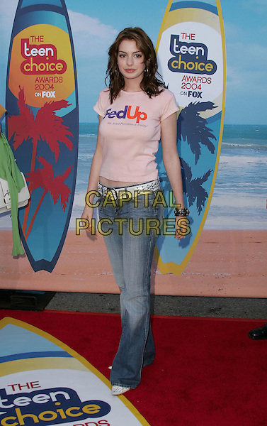 ANNE HATHAWAY.The 2004 Teen Choice Awards held at The Universal Ampitheatre in Universal City, California .August 8, 2004.full length, Fed Up, logo, slogan shirt, pink, jeans, denim, white belt.www.capitalpictures.com.sales@capitalpictures.com.Supplied By Capital Pictures