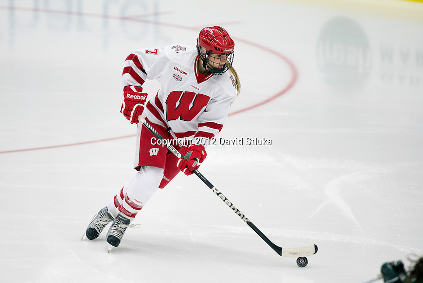 Wisconsin Badgers Kelly Jaminski (7) handles the puck opening night against the Bemidji State Beavers at the LaBahn Arena Friday, October 19, 2012 in Madison, Wis. (Photo by David Stluka)