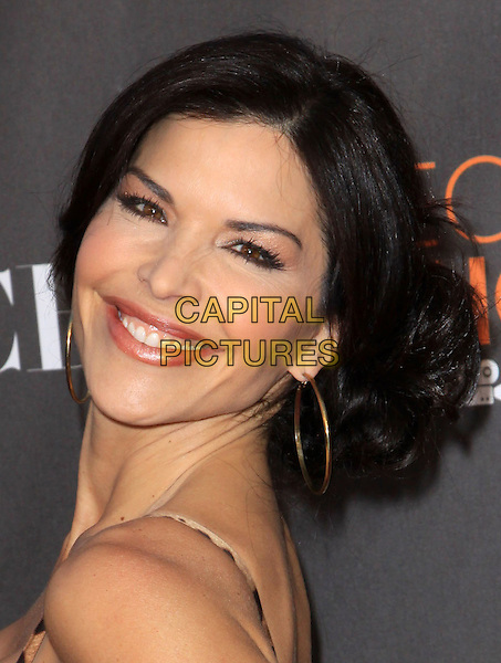 LAUREN SANCHEZ.Arrivals at the 2010 People's Choice Awards held at the Nokia Theater L.A. Live in Los Angeles, California, USA. .January 6th, 2010 .headshot portrait hoop earrings gold brown leopard print looking over shoulder .CAP/ADM/KB.©Kevan Brooks/AdMedia/Capital Pictures.