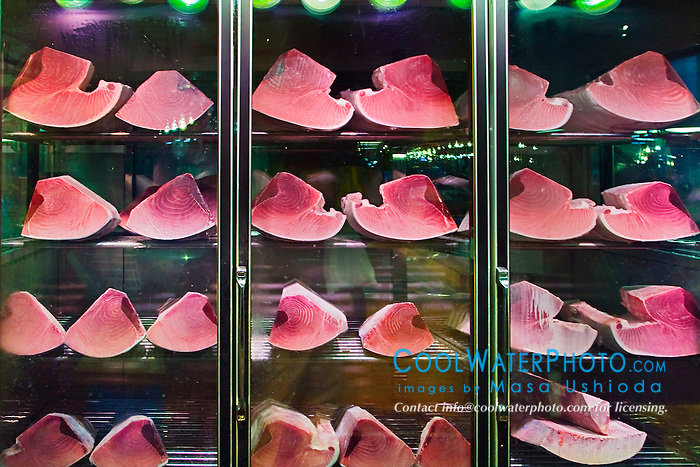 blocks of large tuna meat, Thunnus sp., in refrigerator for sale at wholesale store, Tsukiji Fish Market or Tokyo Metropolitan Central Wholesale Market, the world's largest fish market, hadling over 2,500 tons and over 400 different kind of fresh sea food per day