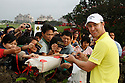 Brendan Jones (AUS) signs autographs during the third round of the Omega Mission Hills World Cup played at The Blackstone Course, Mission Hills Golf Club on November 26th in Haikou, Hainan Island, China.( Picture Credit / Phil Inglis )