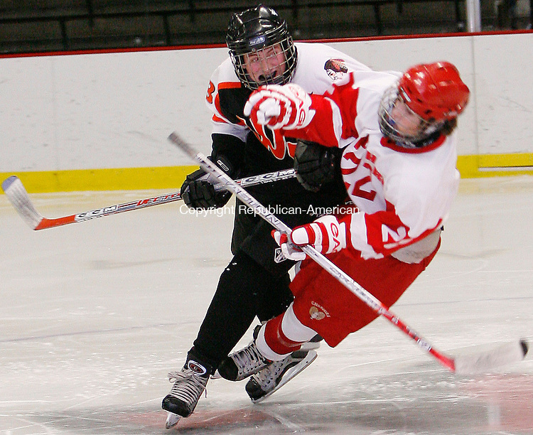 Middletown, CT- 20 December2006-122006MK05 Watertown's Chad Boulier lays a hard check on Cheshire's Nate Guadio Wednesday night at Weslyen University in Middletown. Cheshire shutout Watertown 6 - 0.  Michael Kabelka / Republican-American(Watertown's Chad Boulier lays a hard check on Cheshire's Nate Guadio) CQ