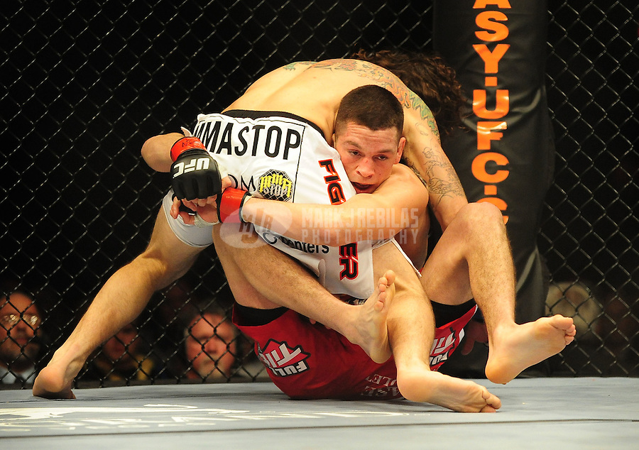 Jan. 31, 2009; Las Vegas, NV, USA; UFC fighter Nate Diaz (red trunks) grabs Clay Guida (white trunks) during the lightweight bout in UFC 94 at the MGM Grand Hotel and Casino. Guida defeated Diaz on a split decision. Mandatory Credit: Mark J. Rebilas-