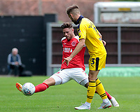 Fleetwood Town's Wes Burns blocks a clearance by Oxford United's Luke Garbutt<br /> <br /> Photographer David Shipman/CameraSport<br /> <br /> The EFL Sky Bet League One - Oxford United v Fleetwood Town - Saturday August 11th 2018 - Kassam Stadium - Oxford<br /> <br /> World Copyright &copy; 2018 CameraSport. All rights reserved. 43 Linden Ave. Countesthorpe. Leicester. England. LE8 5PG - Tel: +44 (0) 116 277 4147 - admin@camerasport.com - www.camerasport.com