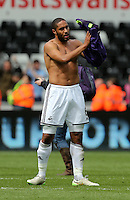 SWANSEA, WALES - MAY 17: Ashley Williams of Swansea thanks home supporters after the Premier League match between Swansea City and Manchester City at The Liberty Stadium on May 17, 2015 in Swansea, Wales. (photo by Athena Pictures/Getty Images)