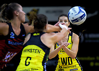 Karin Burger passes to Claire Kersten during the ANZ Premiership netball match between the Central Pulse and Mainland Tactix at TSB Bank Arena in Wellington, New Zealand on Monday, 14 May 2018. Photo: Dave Lintott / lintottphoto.co.nz