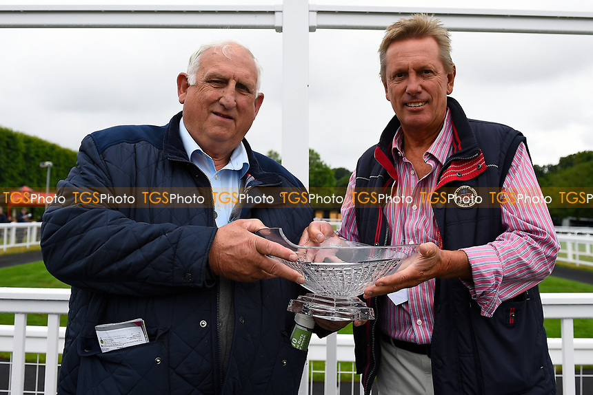Connections of Veejay receive their trophy after winning The New Forest Farm Machinery/John Deere Auction Stakes,  during Whitsbury Manor Stud Bibury Cup Day Racing at Salisbury Racecourse on 28th June 2017