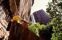 Female hiker by Emerald Pool waterfall in  Zion National Park, Utah, USA