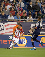 Chivas USA midfielder Gerson Mayen (14) crosses the ball Khano Smith closes. Chivas USA defeated the New England Revolution, 4-0, at Gillette Stadium on May 5, 2010.