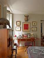Above a French, Louis XVI table in the master bedroom, hangs a collection of drawings by Antony Gormley and a painting by Anish Kapoor. Also displayed is a boar's head and an armadillo - two of many pieces of taxidermy in the apartment