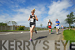 Niamh Foley, Denis McCarthy and Shane Lowth pictured at the Rose of Tralee International 10k Race in Tralee on Sunday.