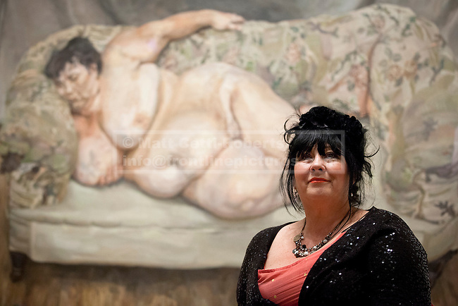 08/02/2012. LONDON, UK. Sue Tilly poses in front of Lucian Frued's 'Benefits Supervisor Sleeping' a portrait of her on display at the National Portrait Gallery. The exhibition entitled 'Lucian Frued Portraits', due to open on the 9th of February 2012, represents one of the largest collections the late artists work ever assembled with over 100 paintings, drawings and etchings on display. Photo credit: Matt Cetti-Roberts