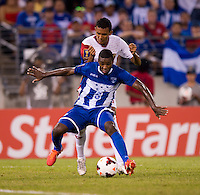 Juan Carlos Garcia (6) of Honduras holds off Osvaldo Rodriguez (10) of Costa Rica during the quarterfinals of the CONCACAF Gold Cup at M&T Bank Stadium in Baltimore, MD.  Honduras defeated Costa Rica, 1-0.