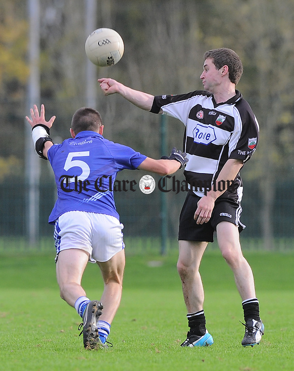 Daithi Collins of Cratloe in action against Sean Talty of Clarecastle during their Junior B county football final in Shannon. Photograph by John Kelly.