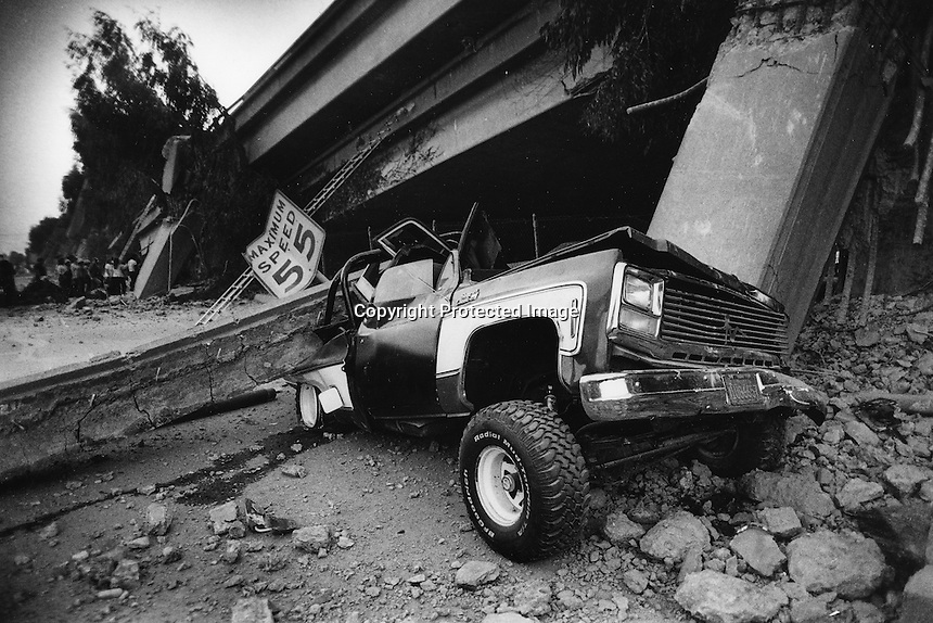 Earthquake, Oct 17, 1989 a crushed truck under the collapsed double-decked Cypress Freeway in Oakland, Ca. (photo Michael Macor/Oakland Tribune)