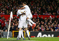 Gylfi Sigurosson of Swansea City celebrates scoring his goal to make it 1-1 with his team-mates during the Barclays Premier League match between Manchester United and Swansea City played at Old Trafford, Manchester on January 2nd 2016