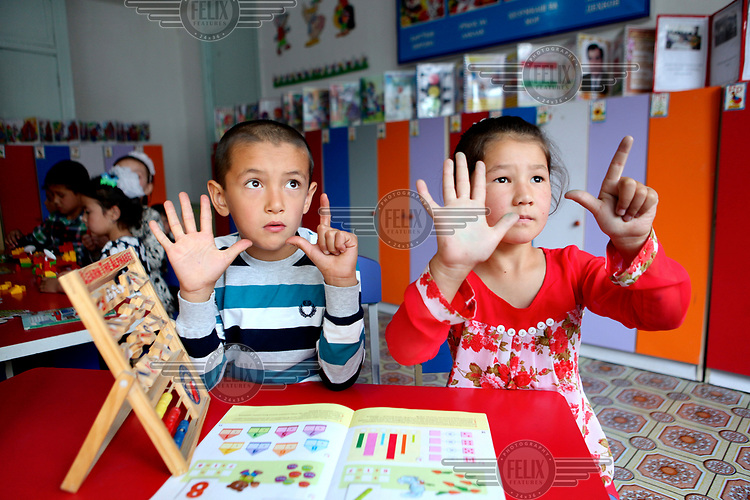 Two children learning at an Early Childhood Education Centre for four to six year olds in Ispisor Jamoat Village.