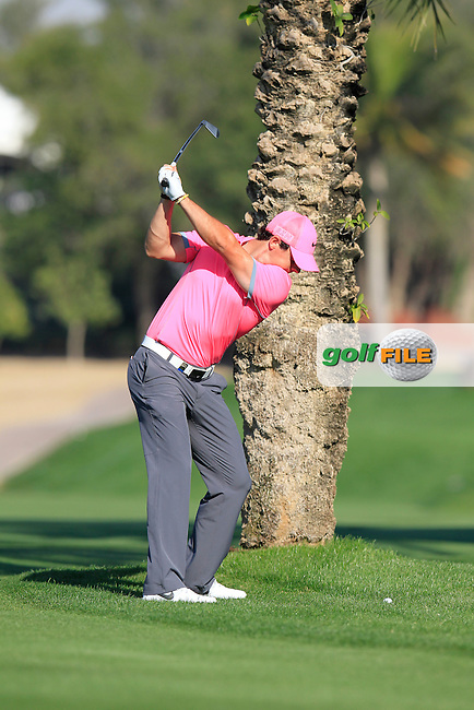 Rory MCILROY (NIR) plays his 2nd shot from behind a tree on the 13th hole during Pink Friday's Round 2 of the 2015 Omega Dubai Desert Classic held at the Emirates Golf Club, Dubai, UAE.: Picture Eoin Clarke, www.golffile.ie: 1/30/2015