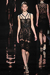 "Model walks runway in a black lace dress with jet black detail from the Reem Acra Fall 2016 ""The Secret World of The Femme Fatale"" collection, at NYFW: The Shows Fall 2016, during New York Fashion Week Fall 2016."