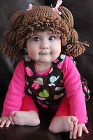 BNPS.co.uk (01202 558833)<br /> Pic: AmandaLillie/BNPS<br /> <br /> ***Please use full byline***<br /> <br /> All dolled up! One of Amanda's customers sports a Cabbage Patch hat. <br /> <br /> A fan of the Cabbage Patch Kids dolls has created a bizarre range of woollen wigs so that people can dress up as the iconic child's toy.<br /> <br /> The original dolls were created in 1978 and had fabric bodies, vinyl heads, and hair made from wool to look like a number of popular styles of the day.<br /> <br /> Although the toys are now made with cornsilk hair, an enthusiast has crocheted wigs to look like the traditional yarn ponytails, plaits, bunches, and ringlets.<br /> <br /> The accessories can be made in a variety of sizes to fit babies, children, and adults who wish to dress up like the popular dolls.<br /> <br /> Amanda Lillie, 32, had the idea for the wacky headwear when she stumbled upon a version online and wanted to make her own improved version.<br /> <br /> She unearthered her own doll collection and studied their hairstyles for inspiration before creating her own from acrylic wool.<br /> <br /> Amanda has now made a variety of different wigs in yellow, brown, black and red and each one takes around two hours to complete.<br /> <br /> They are sold on www.etsy.com/uk/shop/TheLilliePad for prices between &pound;13 and &pound;26.