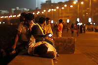 People on the oceanfront walkway Marine Drive, Mumbai, use their mobile phones. Telenor warned it could be forced to reconsider its presence in India if the New Delhi revises the terms of its spectrum licence amid a political scandal over regulation of the Indian telecoms industry.<br /> <br /> Unitech, since renamed Uninor, is one of five companies alleged to have benefited from irregularities that an official audit claimed had cost the Indian government $39bn in lost revenues from spectrum licences. <br /> <br /> Further reading : http://www.ft.com/cms/s/0/f391ebb0-33b4-11e0-b1ed-00144feabdc0.html#axzz1DWW1eUZh