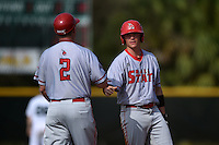 Ball State Cardinals outfielder Alex Call (8) congratulated by head coach Rich Maloney (2) during a game against the Dartmouth Big Green on March 7, 2015 at North Charlotte Regional Park in Port Charlotte, Florida.  Ball State defeated Dartmouth 7-4.  (Mike Janes/Four Seam Images)