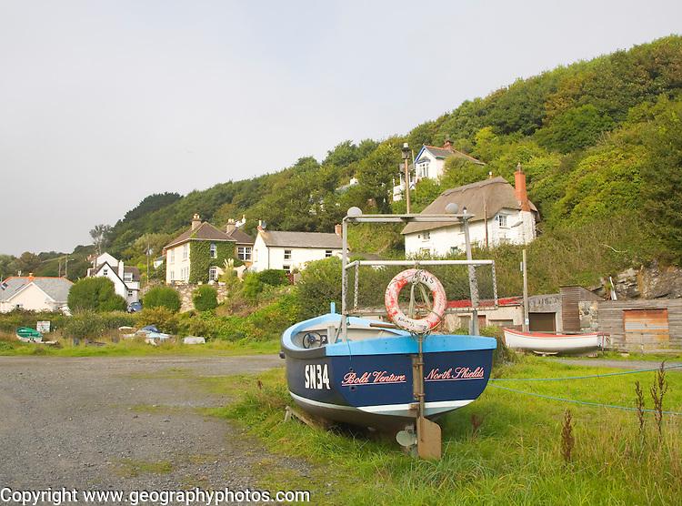 Fishing boats and  village houses at Porthoustock, Cornwall, England