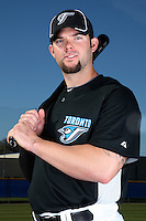 March 1, 2010:  First Baseman Brian Dopirak (11) of the Toronto Blue Jays poses for a photo during media day at Englebert Complex in Dunedin, FL.  Photo By Mike Janes/Four Seam Images
